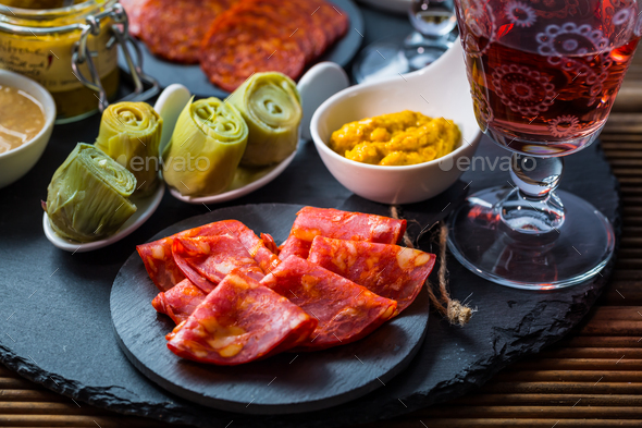 Assortment of tapas and antipasti on black background - Stock Photo - Images