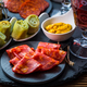 Assortment of tapas and antipasti on black background - PhotoDune Item for Sale