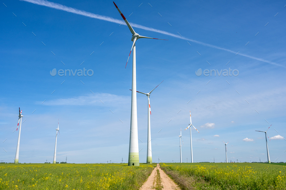 Modern wind turbines and a country road - Stock Photo - Images