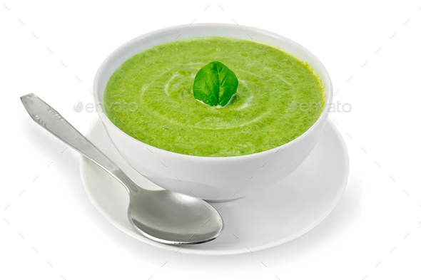 Soup puree with spinach in bowl with spoon - Stock Photo - Images