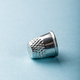 vintage silver thimble on blue - PhotoDune Item for Sale