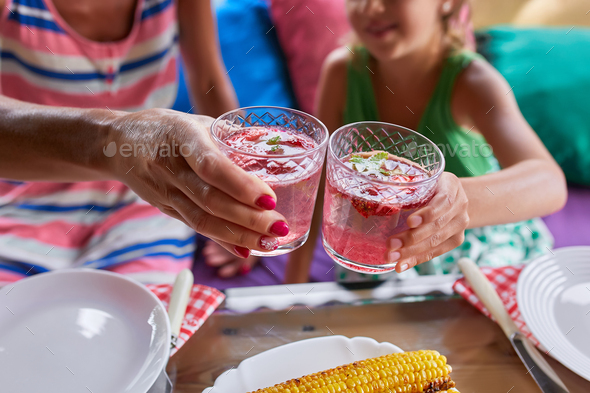 Enjoying dinner with mother and daughter, cheers toast - Stock Photo - Images