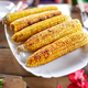 Grilled corn cobs on plate on the dinner table, appetizers - PhotoDune Item for Sale