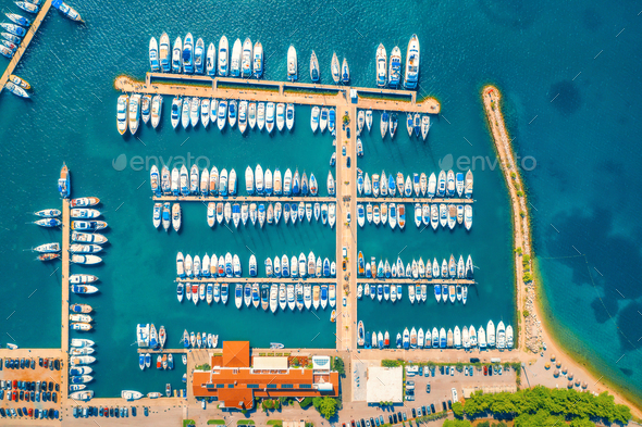 Aerial view of boats and yachts in port in old city at sunset - Stock Photo - Images