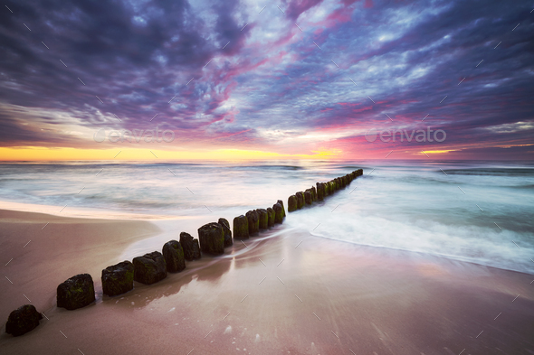 Baltic Sea coast in Mrzezyno at a beautiful sunset, Poland. - Stock Photo - Images