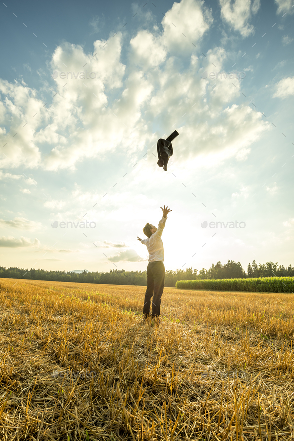 Businessman Throwing Coat in the Air at the Field - Stock Photo - Images