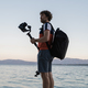 Male photographer holding his camera on gimbal stick - PhotoDune Item for Sale