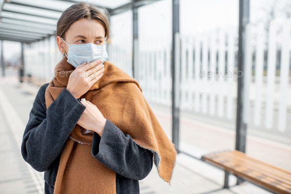 Woman with face mask during epidemic outdoors