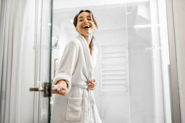 Woman going to the bathroom - Stock Photo - Images