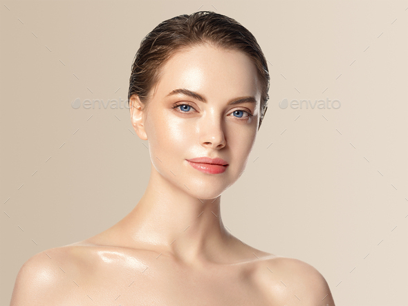 Woman cosmetic closeup beauty portrait healthy care skin and hair over beige color background - Stock Photo - Images