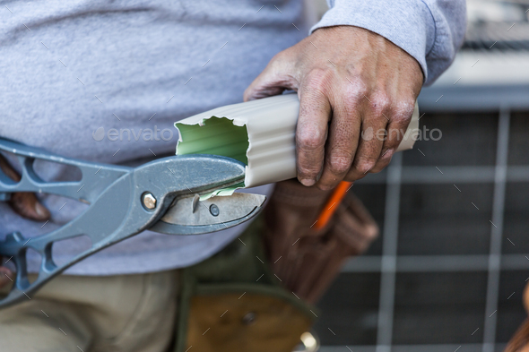 Worker Cutting Aluminum Rain Gutter With Heavy Shears - Stock Photo - Images