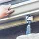 Worker Attaching Aluminum Rain Gutter to Fascia of House - PhotoDune Item for Sale