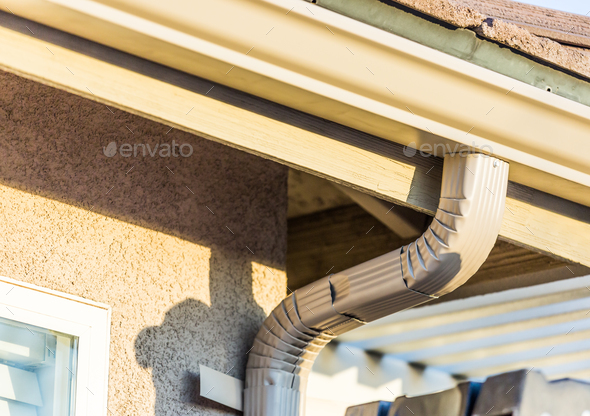 House with New Seamless Aluminum Rain Gutters - Stock Photo - Images