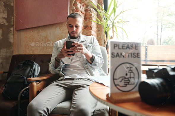 Surfing net on smartphone in cafe - Stock Photo - Images