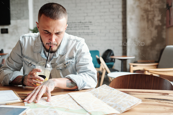Finding best places to visit in cafe - Stock Photo - Images