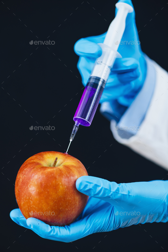 Spiking Fruits with Chemicals to Boost Sales. Foul Practice of Injecting Chemicals into Apple Fruit - Stock Photo - Images