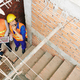 Contractors standing at staircase flight - PhotoDune Item for Sale