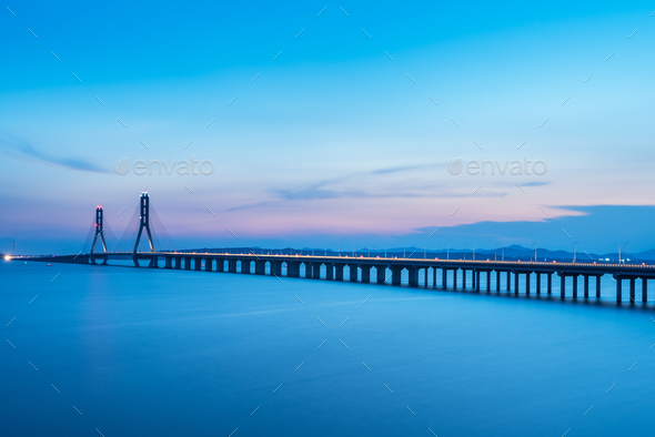 cable-stayed bridge in nightfall - Stock Photo - Images
