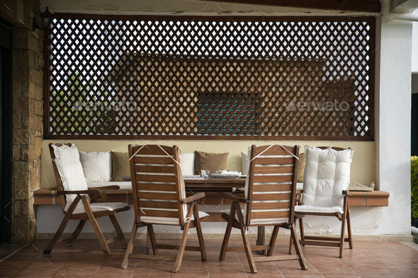 Wooden Table and Comfortable Chairs on a Porch - Stock Photo - Images