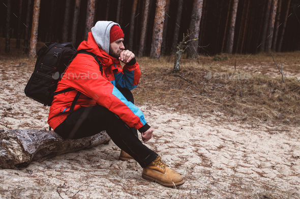 Hiker resting in the forest - Stock Photo - Images