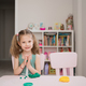 Cute little girl moulds from plasticine on table - PhotoDune Item for Sale