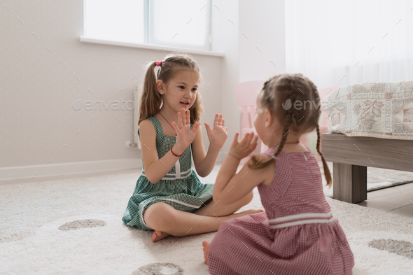 carefree cute girls playing lovely at home - Stock Photo - Images