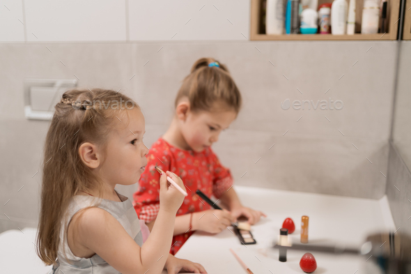Child cosmetics Cute little girls - Stock Photo - Images