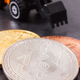 Bitcoins and miniature excavator, symbol of new virtual money and mining cryptocurrency - PhotoDune Item for Sale