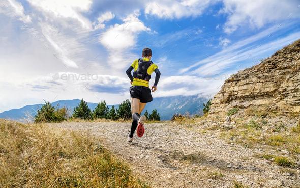 athlete runner run mountain trail - Stock Photo - Images