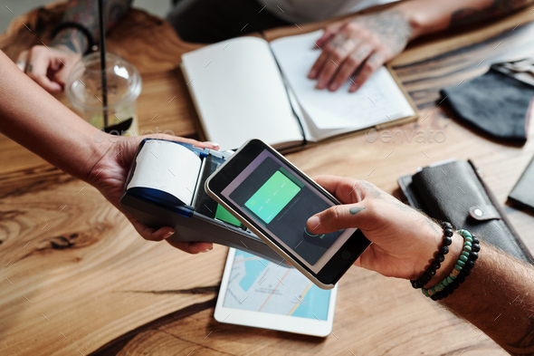 Using contactless payment in cafe - Stock Photo - Images