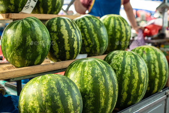 Stacked rows of fresh fruit in the market - Stock Photo - Images