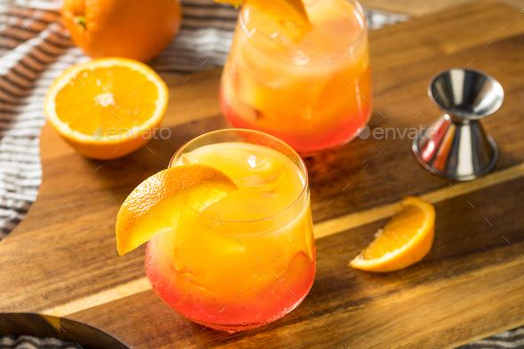 Boozy Refreshing Tequila Sunrise Cocktail - Stock Photo - Images