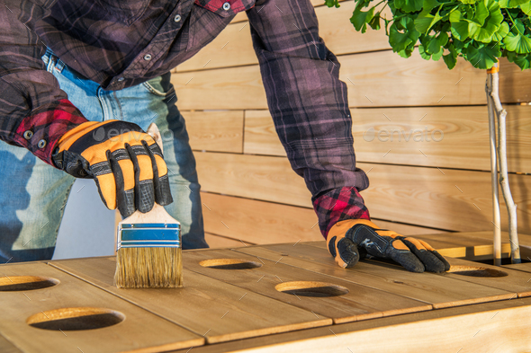 Protecting Wood Furniture With Oiling. - Stock Photo - Images