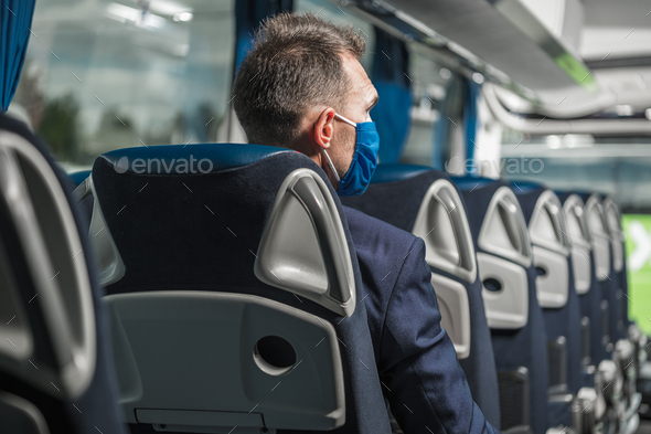 Male Passenger With Face Mask Sitting Inside Of Bus. - Stock Photo - Images