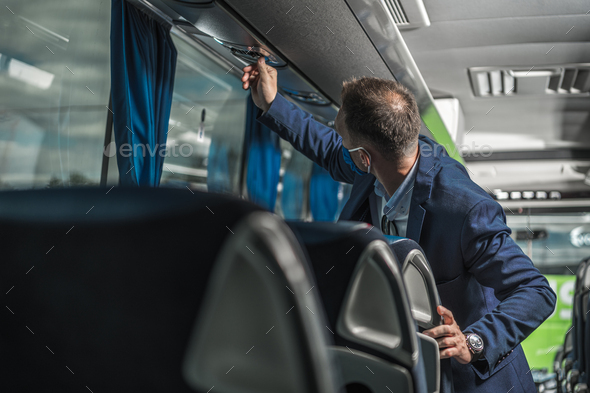 Shuttle Driver Checking Air Conditioning System In Bus. - Stock Photo - Images