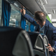 Shuttle Driver Checking Air Conditioning System In Bus. - PhotoDune Item for Sale
