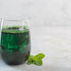 Green drink prepared with chlorella. Detox superfood in the glass with copy space - PhotoDune Item for Sale