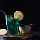 Green drink prepared with green chlorella. Detox superfood in the glass. Dark and moody - PhotoDune Item for Sale