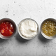 Traditional mexican sauces on the gray concrete background - PhotoDune Item for Sale