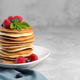 Pancakes with blueberries, raspberries, mint and honey for a breakfast - PhotoDune Item for Sale