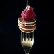 Tiny cereal pancakes with raspberries strung on a fork with pouring honey on a dark background - PhotoDune Item for Sale
