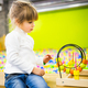 Girl playing with a developmental toy - PhotoDune Item for Sale