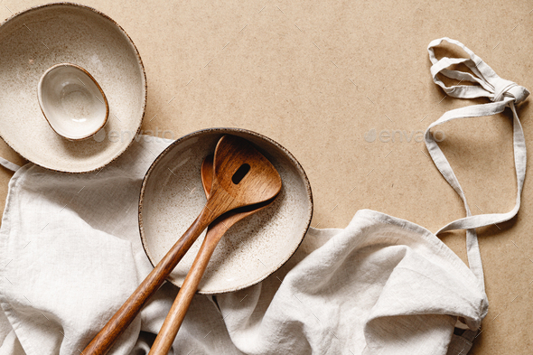 Modern minimalist ceramics set with a linen cloth over kraft paper background. - Stock Photo - Images