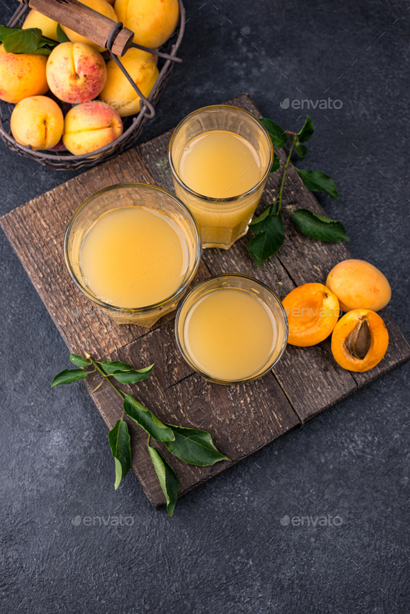 Apricot juice in glass. Healthy drink - Stock Photo - Images