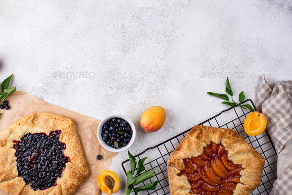 Sweet homemade galette pie with fruits - Stock Photo - Images