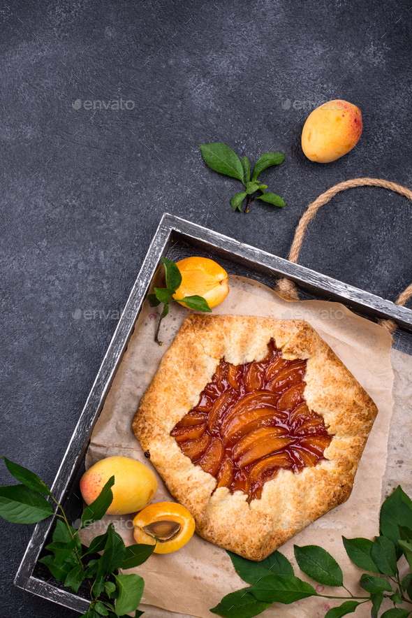 Sweet homemade galette pie with apricots - Stock Photo - Images
