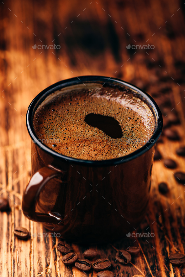 Brewed black coffee in metal mug - Stock Photo - Images