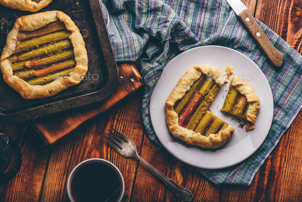 Sliced rhubarb mini galettes on white plate - Stock Photo - Images
