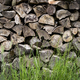 A neatly stacked pile of logs, a firewood log store. - PhotoDune Item for Sale