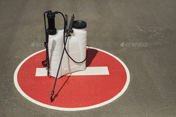 Disinfection Equipment on Stop Sign - Stock Photo - Images